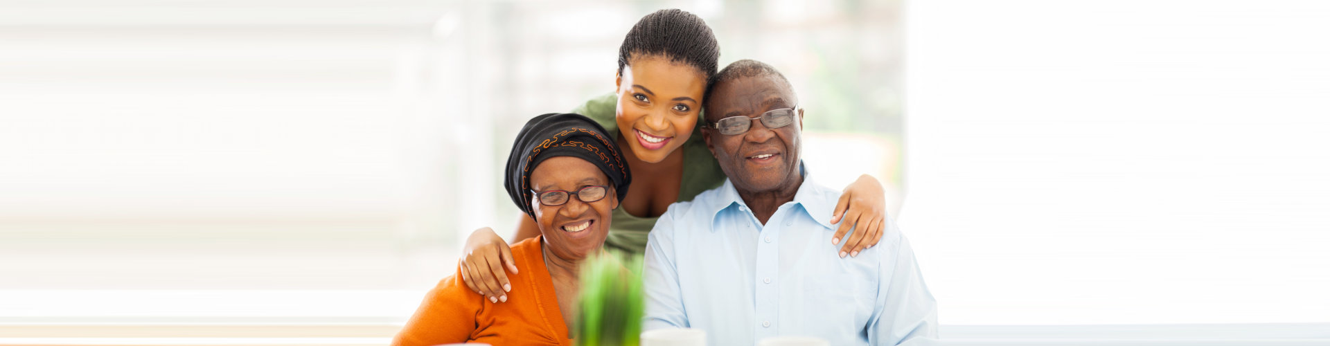 elderly couple with their caregiver