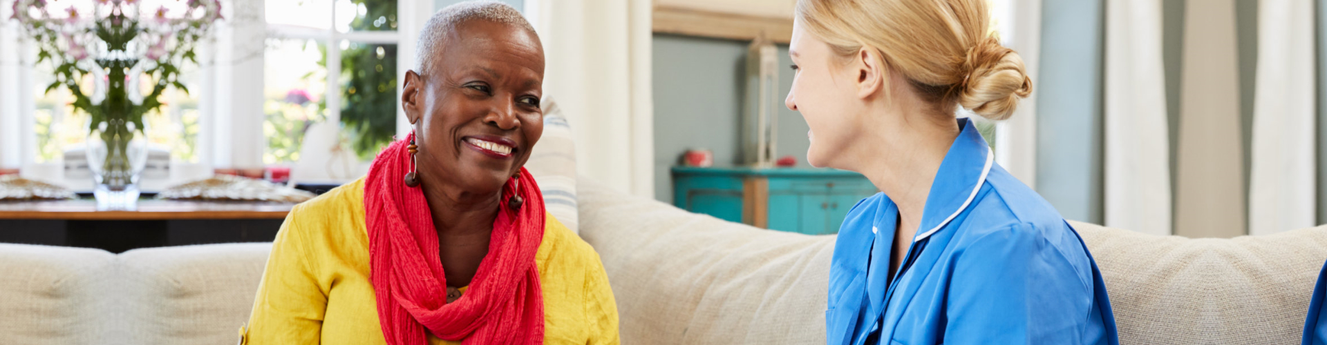 senior woman and a caregiver talking